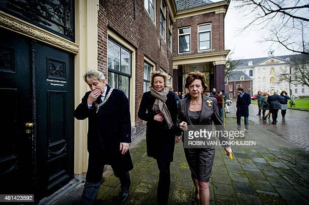 Dutch former European Commissioner for Digital Agenda Neelie Kroes is welcomed by mayor of Amsterdam Eberhard van der Laan and alderman Kajsa...