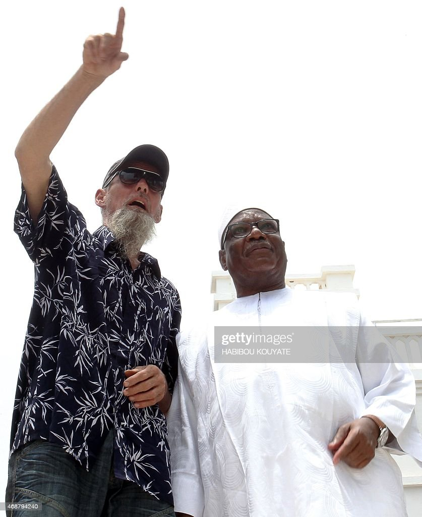 Dutch former hostage Sjaak Rijke (L) gestures as he speaks with Malian President Ibrahim Boubacar Keita at the presidential palace in Bamako on April 7, 2015, one day after his release. French special forces on April 6, 2015 rescued Dutch train driver Sjaak Rijke, kidnapped in Timbuktu in northern Mali in November 2011 by Al-Qaeda in the Islamic Maghreb (AQIM), in an operation that killed several jihadists.