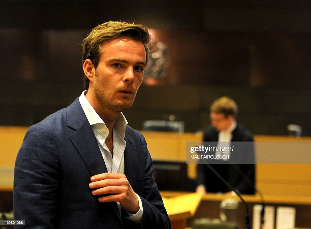 Dutch Formula One driver Giedo van der Garde leaves the court in Melbourne on March 11, 2015, which ruled he can drive for Sauber at the season-opening Formula One Grand Prix in Melbourne this weekend. Van der Garde had claimed he was guaranteed a drive for the 2015 season but that the Swiss team reneged on the deal and instead handed births to Sweden's Marcus Ericsson and rookie Brazilian Felipe Nasr. USE