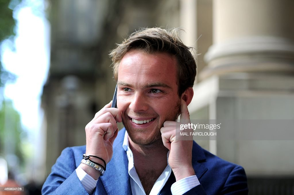 Dutch Formula One driver Giedo van der Garde reacts outside the Victorian Supreme Court in Melbourne on March 11, 2015, which ruled he can drive for Sauber at the season-opening Formula One Grand Prix in Melbourne this weekend. Van der Garde had claimed he was guaranteed a drive for the 2015 season but that the Swiss team reneged on the deal and instead handed births to Sweden's Marcus Ericsson and rookie Brazilian Felipe Nasr. USE