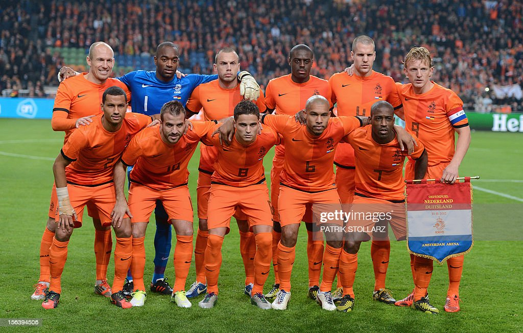 Dutch forward Arjen Robben (back row from L.), Dutch goalkeeper Kenneth Vermeer , Dutch defender John Heitinga , Dutch defender Bruno Martins Indi , Dutch defender Ron Vlaar , Dutch forward Dirk Kuyt , Dutch defender Ricardo van Rhjin (bottom from L.), Dutch midfielder Rafael van der Vaart , Dutch forward Ibrahim Afellay , Dutch midfielder Nigel de Jong and Dutch forward Ruben Schaken pose for a picture prior to the friendly football match Netherlands vs Germany on November 14, 2012 in Amsterdam. AFP PHOTO / PATRIK STOLLARZ