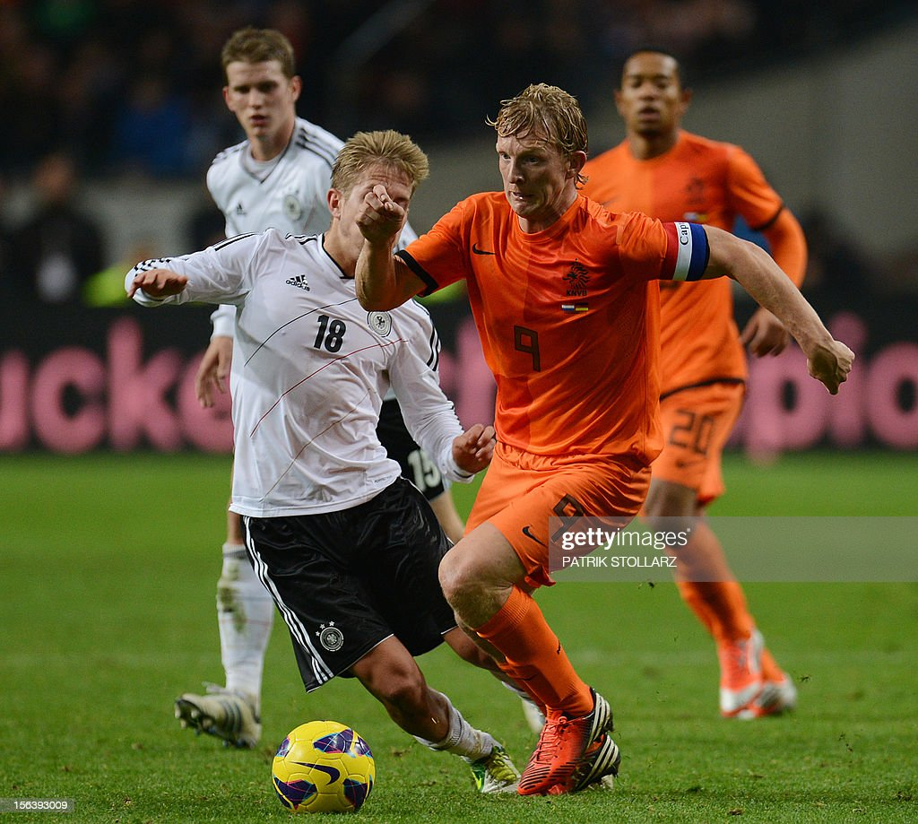 Dutch forward Dirk Kuyt (R) and German midfielder Lewis Holtby during the friendly football match Netherlands vs Germany on November 14, 2012 in Amsterdam.