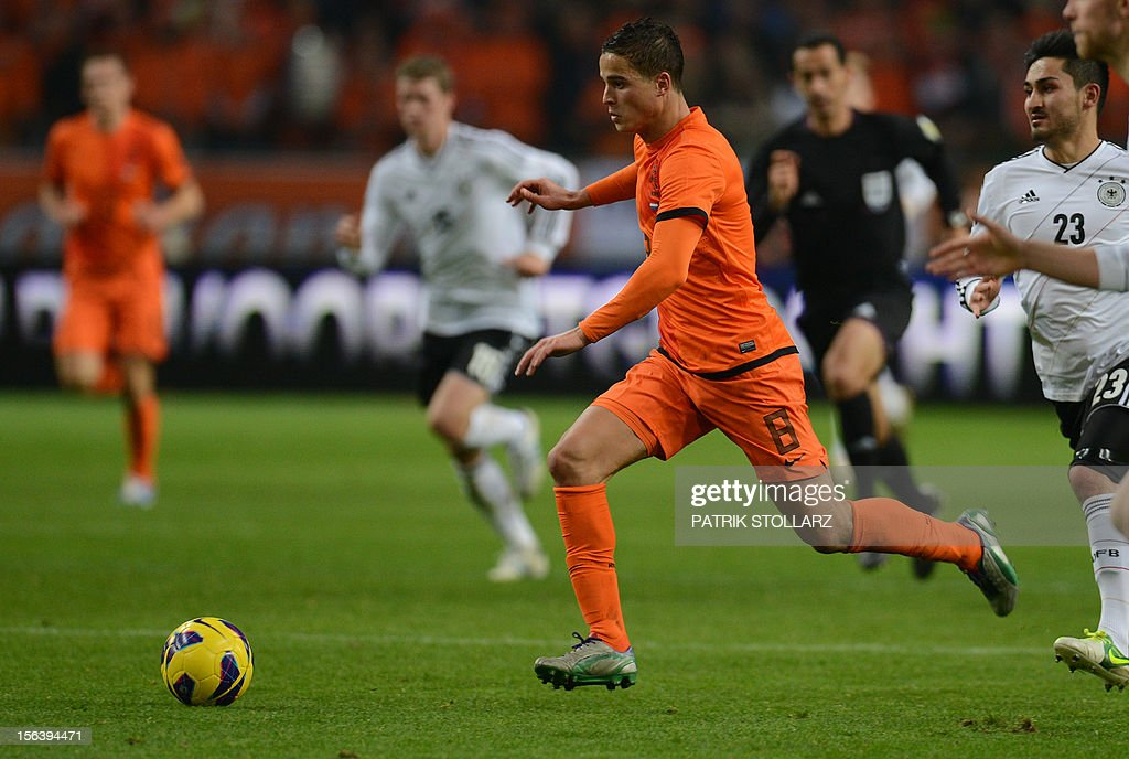 Dutch forward Ibrahim Afellay runs after the ball during the friendly football match Netherlands vs Germany on November 14, 2012 in Amsterdam.