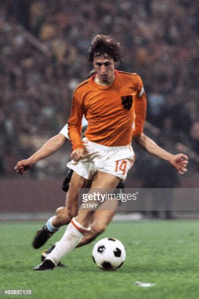 Dutch forward Johan Cruyff controls the ball under pressure from a West German player during the World Cup quarterfinal soccer match between the...