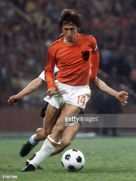 Dutch forward Johan Cruyff controls the ball under pressure from a West German player during the World Cup final between West Germany and the...