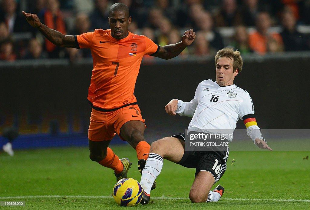 Dutch forward Ruben Schaken (L) vies with German defender Philipp Lahm during the friendly football match Netherlands vs Germany on November 14, 2012 in Amsterdam. AFP PHOTO / PATRIK STOLLARZ
