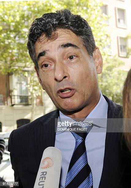 Dutch Gerard Spong lawyer of Argentinian born Dutch pilot Julio Alberto Poch talks to the press in front of the high court in Madrid on October 6...