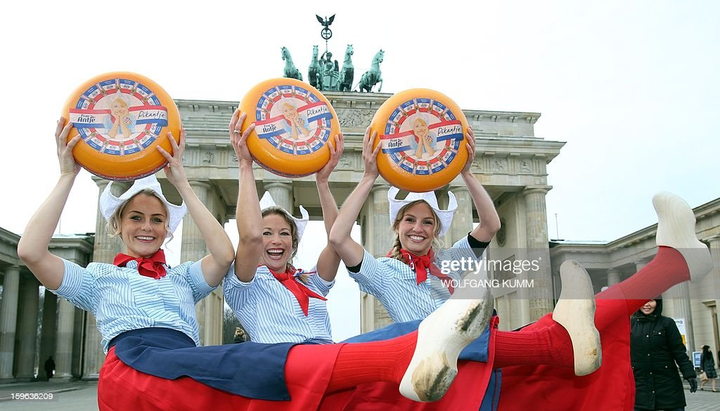 Dutch girls present on January 17, 2013 the cheese for the Green Week Agricultural Fair, at the Brandenburg Gate in Berlin. The International Green Week takes place from January 18 to 27 in Berlin.