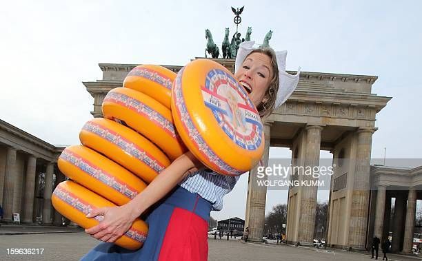 Dutch girls present on January 17 2013 the cheese for the Green Week Agricultural Fair at the Brandenburg Gate in Berlin The International Green Week...