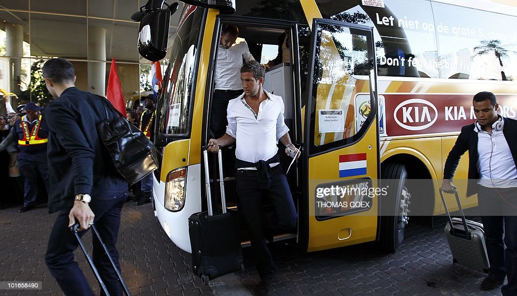 Dutch goalkeeper Maarten Stekelenburg (C) gets down from the bus on the national football team's arrival at their hotel in Sandton, northern Johannesburg, on June 6, 2010. The Dutch face Denmark, Japan and Cameroon in the first round group stage of the South Africa 2010 World Cup.