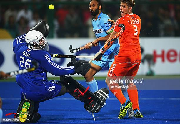 Dutch goalkeeper Pirmin Blaak saves from Sardar Singh captain of India during the match between Netherlands and India on day ten of The Hero Hockey...