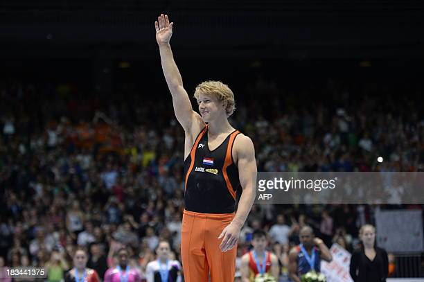 Dutch gold medalist Epke Zonderland celebrates during the podium ceremony of the men's horizontal bar event at the 44th Artistic Gymnastics World...