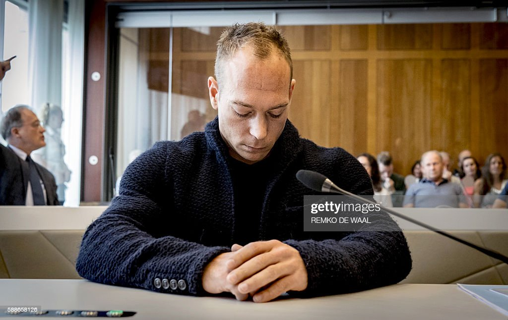 TOPSHOT Dutch gymnast Yuri van Gelder sits at the start of a case summarily at the court of Arnhem on August 12 2016 after being kicked off his...