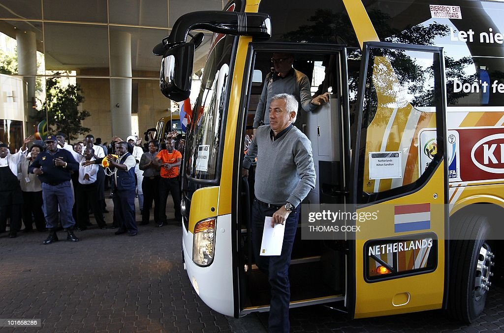 Dutch head coach Bert van Marwijk (R) gets down from the bus as he arrives with the national football team at their hotel in Sandton, northern Johannesburg, on June 6, 2010. The Dutch face Denmark, Japan and Cameroon in the first round group stage of the South Africa 2010 World Cup.