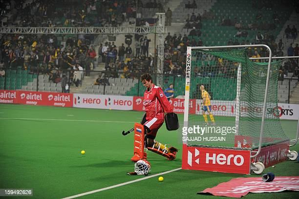 Dutch hockey goalkeeper Jaap Stockmann playing for Punjab Warriors warms up on the field prior to the inaugural match of the Hockey India League...