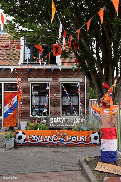 Dutch house decorated over the top with orange material to celebrate the soccer world cup 2014