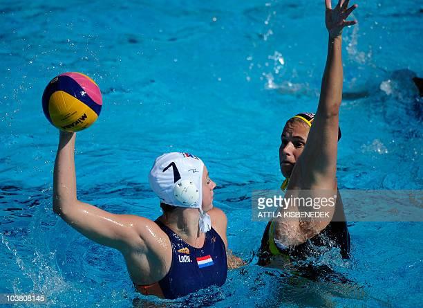 Dutch Iefke van Belkum tries to shoot against German Claudia Blomenkamp in the Mladost venue swimming pool in Zagreb on September 2 2010 during their...