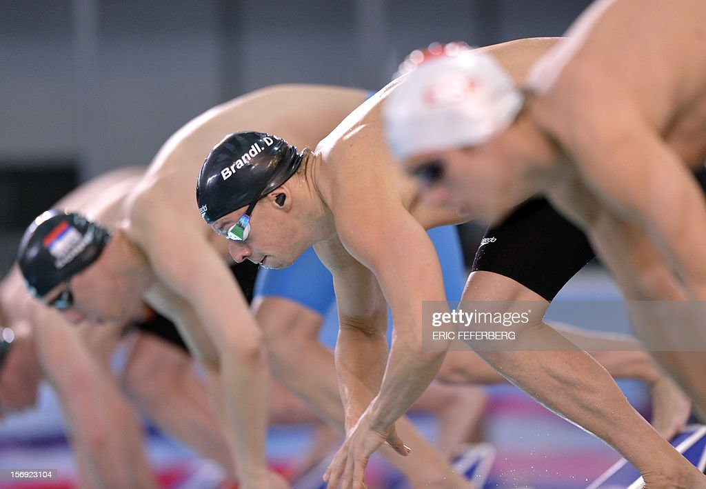 Dutch Joost Reijns (C) takes the start of the men's 200m freestyle race on November 25, 2012 of the European short course swimming championships in the central French city of Chartres.