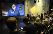 Dutch journalists ask questions via a large screen during the first press conference by the Dutch astronaut Andre Kuipers after his return to Earth...