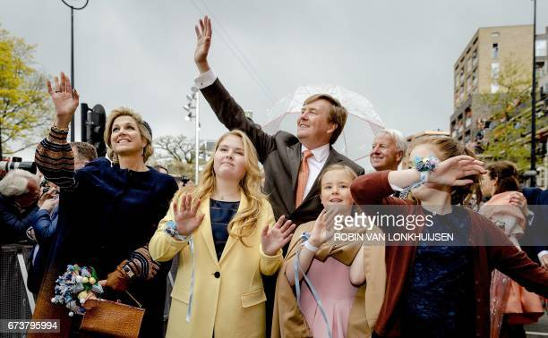 Dutch King Willem Alexander Queen Maxima and their daughters Amalia Ariane and Alexia wave to the crowd as the king celebrates his 50th birthday in...