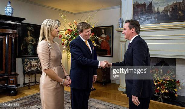 Dutch King WillemAlexander and his wife Queen Maxima greet British Prime Minister David Cameron at the Royal Palace Huis ten Bosch in The Hague on...