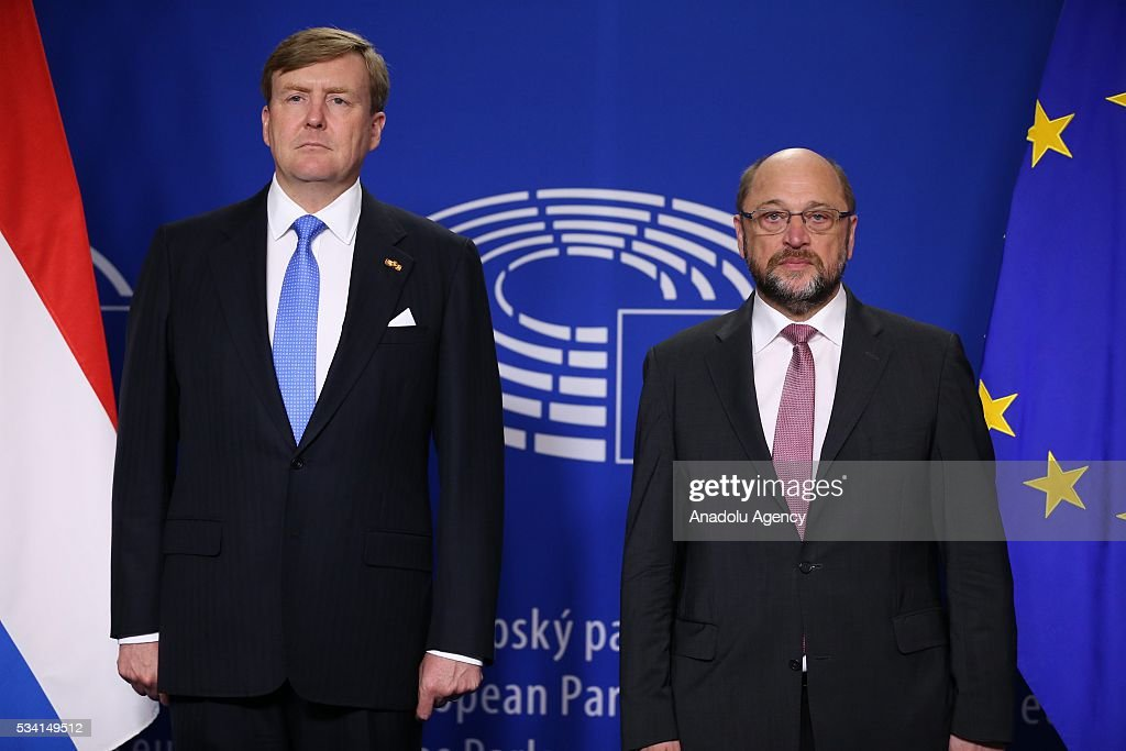 Dutch King Willem-Alexander (L) and President of the European Parliament Martin Schulz (R) stand in silence before their meeting in Brussels, Belgium on May 25, 2016.