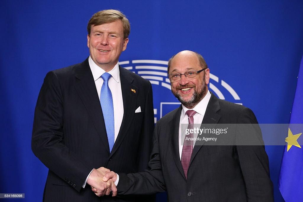 Dutch King Willem-Alexander (L) and President of the European Parliament Martin Schulz (R) shake hands prior to their meeting in in Brussels, Belgium on May 25, 2016.