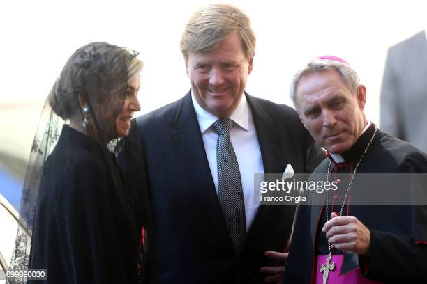Dutch King WillemAlexander and Queen Maxima are welcomed by the prefect of the papal household Georg Gaenswein as they arrive at the Vatican for an...
