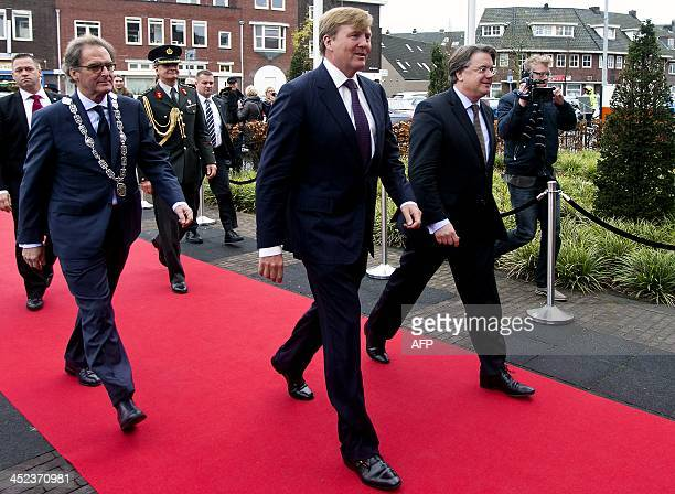 Dutch King WillemAlexander arrives together with mayor Ton Rombouts and King's Commissioner Wim van der Donk to attend the 100th year anniversary of...