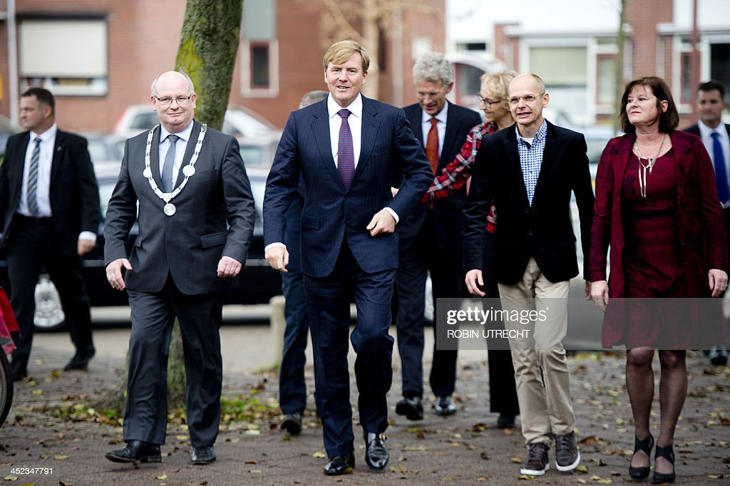 Dutch King Willem-Alexander (C) arrives with Mayor Frans Backhuijs (L) of Nieuwegein and teachers at the Prago school in Nieuwegein, the Netherlands, on November 28, 2013. Prago is an evening school for adults with language or learning disabilities and is supported by the Oranje Fonds, the largest foundation in the area of social welfare in the Netherlands. AFP PHOTO / ANP / ROBIN UTRECHT OUT--