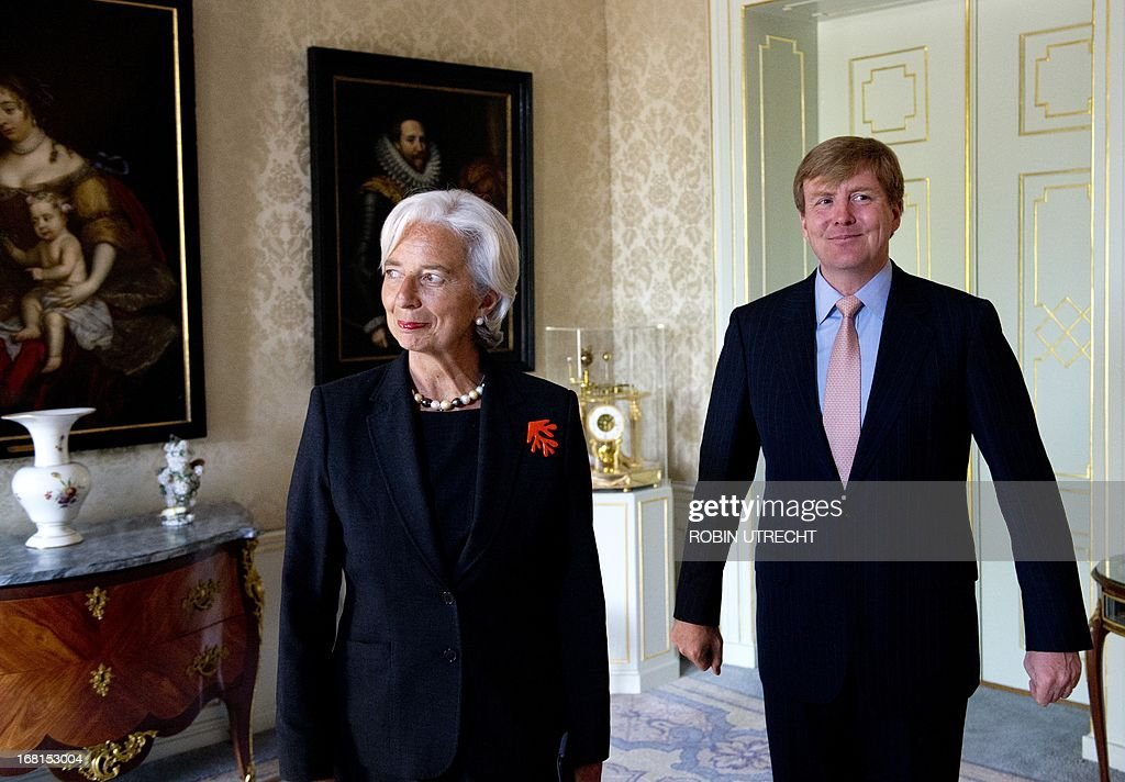 Dutch King Willem-Alexander chats with International Monetary Fund (IMF) managing director Christine Lagarde during an audience at the Huis ten Bosch in The Hague, on May 6, 2013. Christine Lagarde, former French Finance minister, is in a two-day visit to the Netherlands.