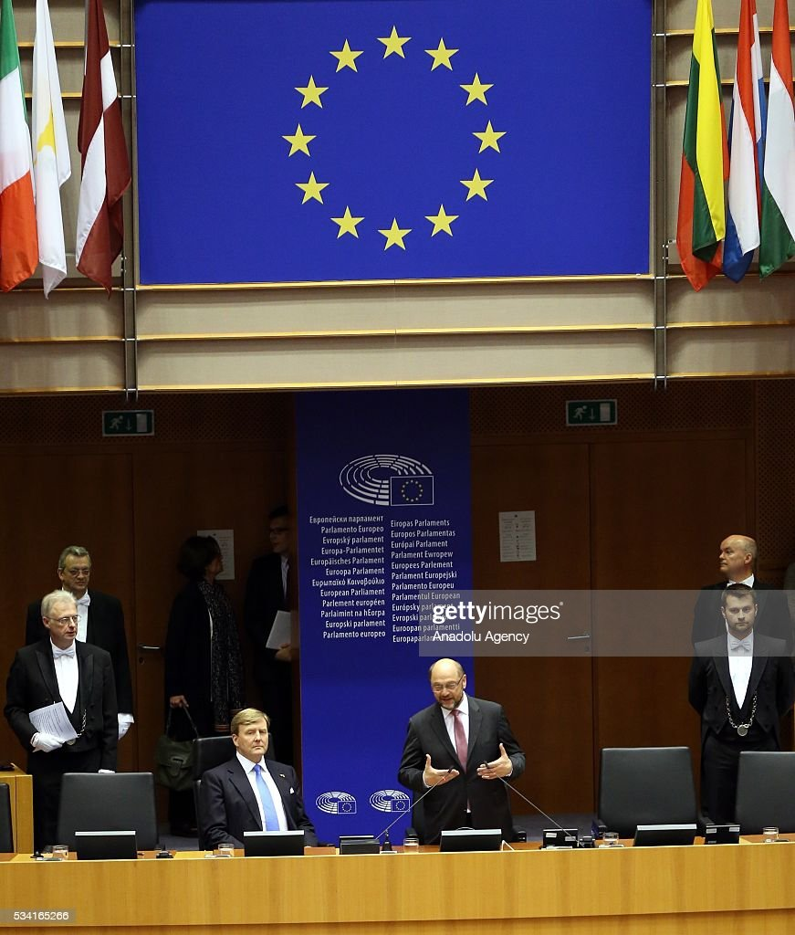 Dutch King Willem-Alexander (center R) delivers a speech at European Parliament's general assembly hall as President of the European Parliament Martin Schulz (center L) stand next to him after their meeting in Brussels, Belgium on May 25, 2016.