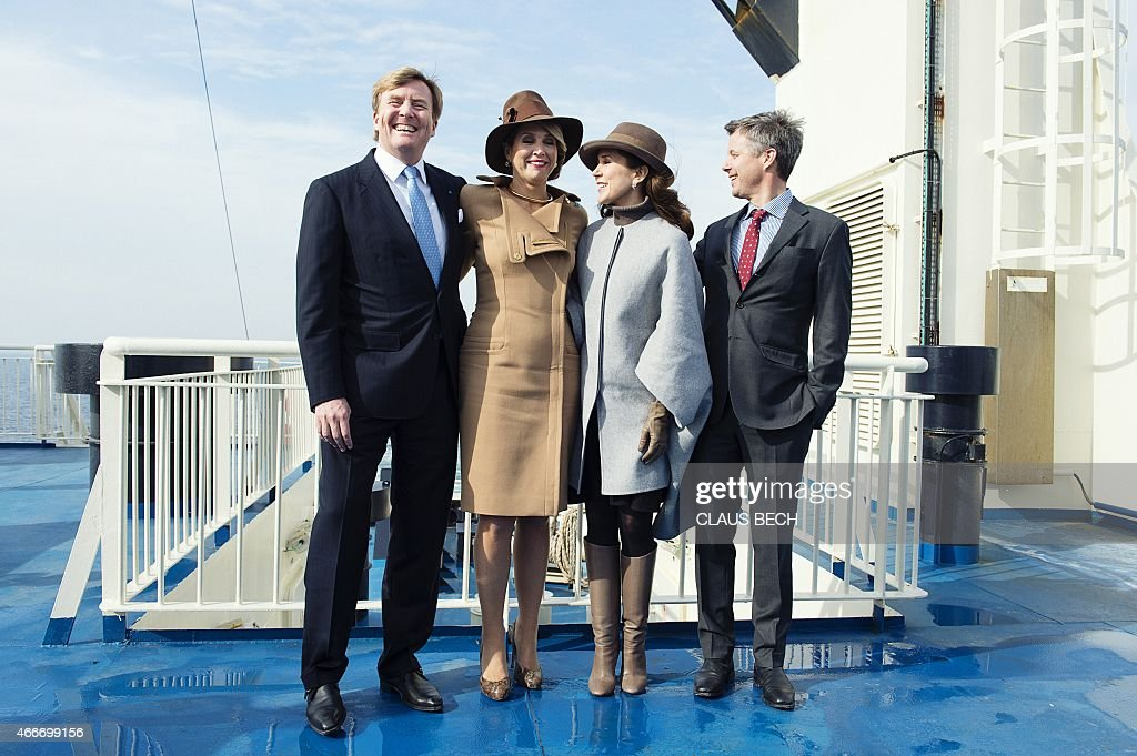 Dutch King Willem-Alexander, Dutch Queen Maxima, Danish Crown Princess Mary and Danish Crown Prince Frederik pose for a photo on a ferry boat after visiting the island Samsoe, Denmark, on March 18, 2015. The Dutch royal couple is on two-day state visit in Denmark.