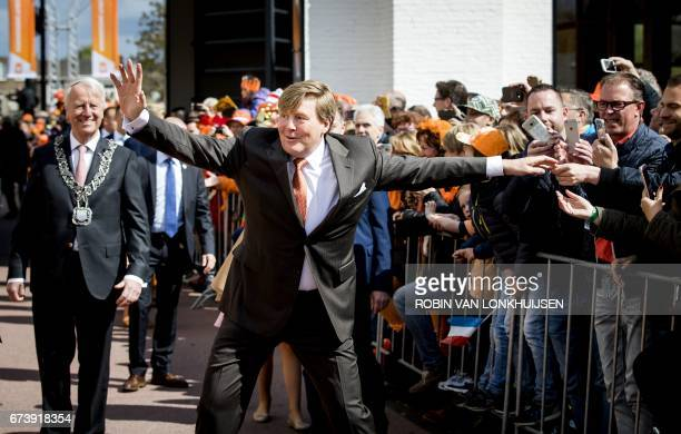 Dutch King WillemAlexander gestures as he celebrates his 50th birthday on the traditional King's Day in Tilburg the Netherlands on April 27 2017 /...