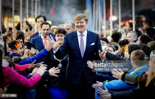 TOPSHOT Dutch King WillemAlexander hands out high fives during the celebration of the 50th anniversary of the city Lelystad in Lelystad on November...