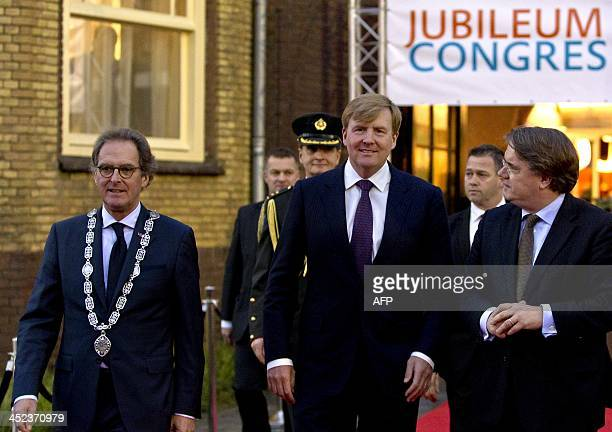 Dutch King WillemAlexander leaves together with mayor Ton Rombouts and King's Commissioner Wim van der Donk after attending the 100th year...