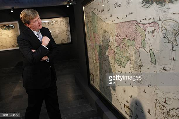 Dutch King WillemAlexander looks at a map during the opening of the exposition 'Atlas der Neederlanden the dawn of the Kingdom' at the University of...