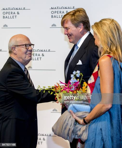 Dutch king WillemAlexander Queen Maxima and choreographer Hans van Manen arrive at the National Opera on September 15 2017 in Amsterdam / AFP PHOTO /...