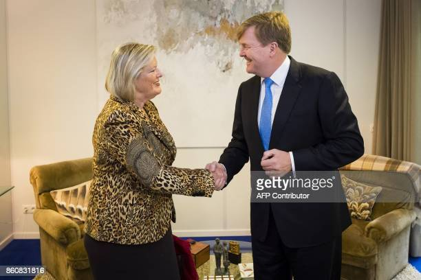 Dutch king WillemAlexander receives at the Eikenhorst Senate chamber president Ankie BroekersKnol on October 13 2017 in Wassenaar after the leaders...