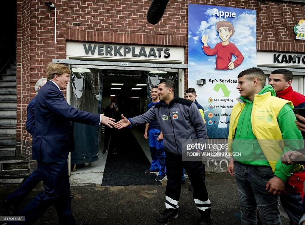 dutch-king-willemalexander-shakes-hands-at-the-haagse-markt-during-picture-id517064282
