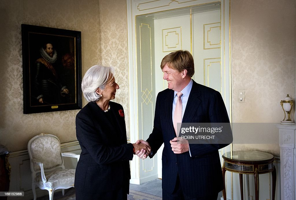 Dutch King Willem-Alexander shakes hands with International Monetary Found (IMF) managing director Christine Lagarde during an audience at the Huis ten Bosch in The Hague, on May 6, 2013. Christine Lagarde, former French Finance minister, is in a two-day visit to the Netherlands.
