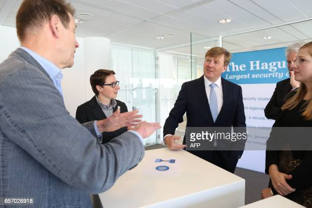 Dutch King WillemAlexander visits The Hague Security Delta Campus in The Hague on March 23 2017 Companies institutions and governments have joined...