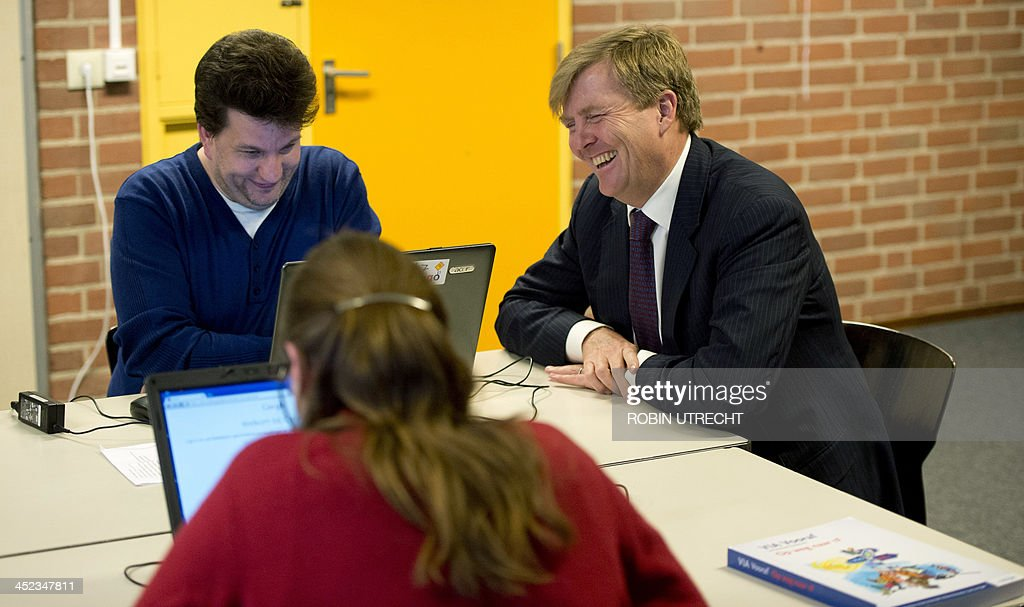 Dutch King Willem-Alexander (R) visits with students at the Prago school in Nieuwegein, the Netherlands, on November 28, 2013. Prago is an evening school for adults with language or learning disabilities and is supported by the Oranje Fonds, the largest foundation in the area of social welfare in the Netherlands.