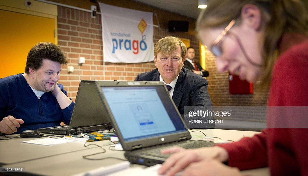 Dutch King Willem-Alexander (C) visits with students at the Prago school in Nieuwegein, the Netherlands, on November 28, 2013. Prago is an evening school for adults with language or learning disabilities and is supported by the Oranje Fonds, the largest foundation in the area of social welfare in the Netherlands.