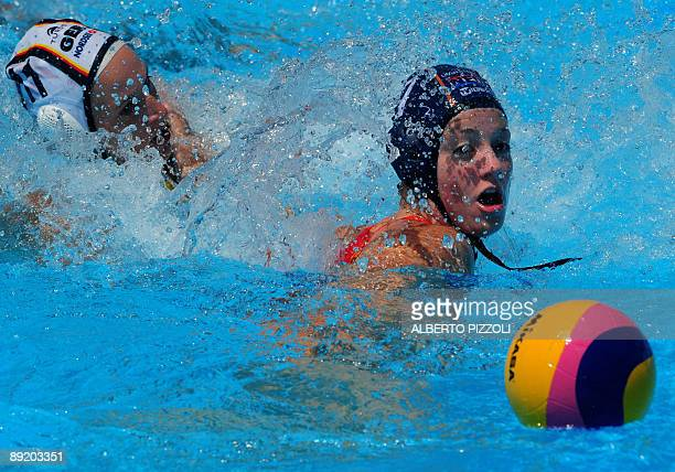 Dutch Lefke van Belkum fights for the ball with German Carmen Gelse during the waterpolo group D game Germany vs Netherlands on July 23 2009 at the...