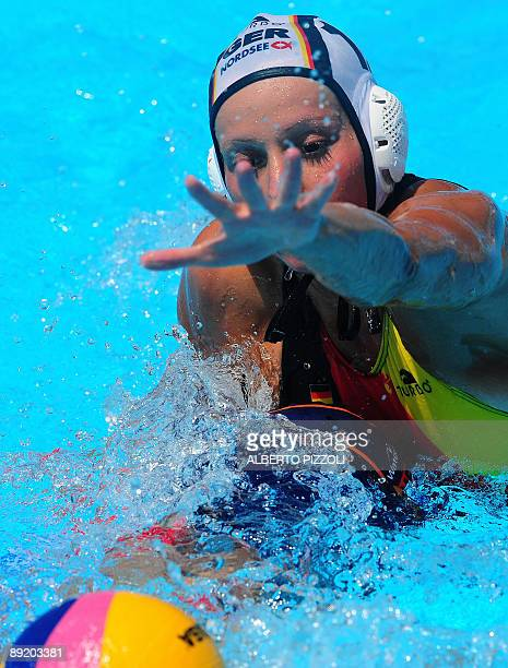 Dutch Lefke van Belkum fights for the ball with German Mandy Zollner during the waterpolo group D game Germany vs Netherlands on July 23 2009 at the...