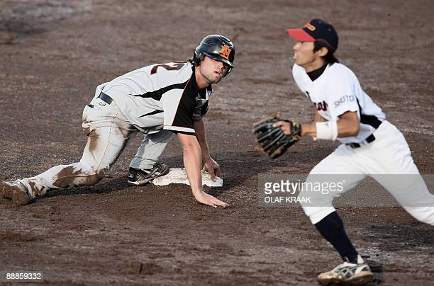 Dutch MarkJan Moorman and Yohei Yamato of Japan look for the ball during the World Port Honkbal Tournament 2009 in Rotterdam on July 06 2009 The...