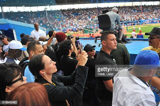 Dutch member of the Colombian FARCEP guerrilla Tanja Nijmeijer takes some photographs before the start of a baseball exhibition game between Cuba and...