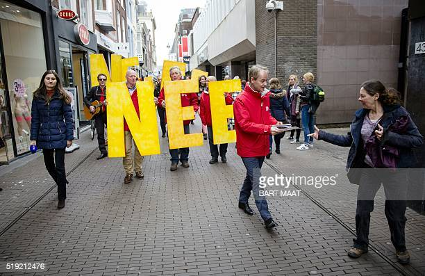 Dutch member of the Socialist Party Harry van Bommel hands out flyers against a referendum on the association treaty with Ukraine in The Hague on...