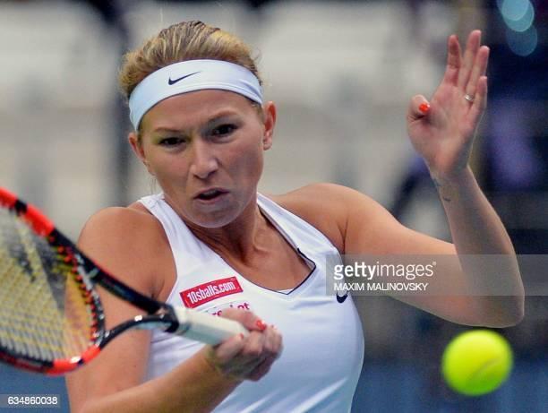 Dutch Michaella Krajicek returns a ball to Belarus' Aryna Sabalenka during the Fed Cup World Group first round tennis match between Belarus and...